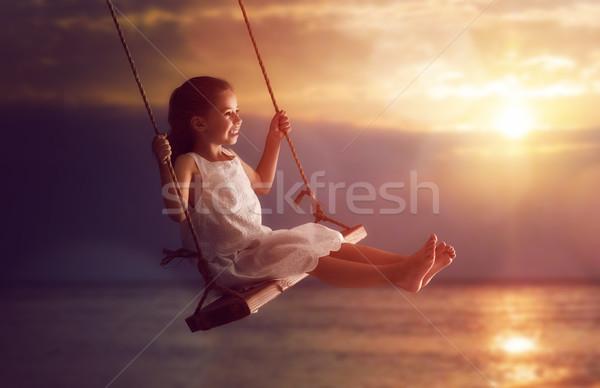 ребенка девушки Swing счастливым закат лет Сток-фото © choreograph