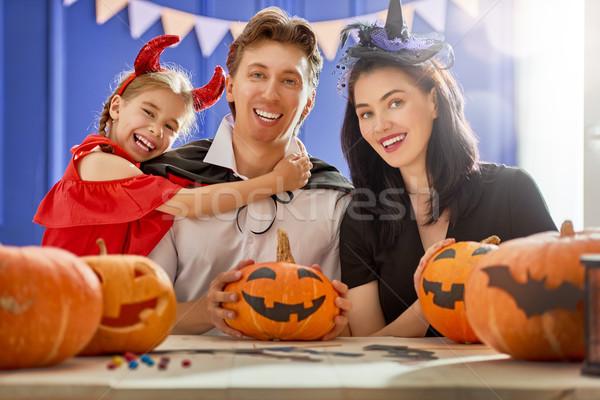 Család ünnepel halloween anya apa lánygyermek Stock fotó © choreograph