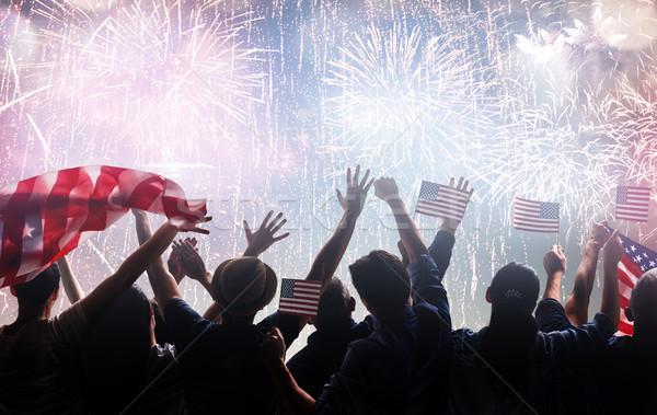 Silhuetas pessoas bandeira EUA patriótico Foto stock © choreograph