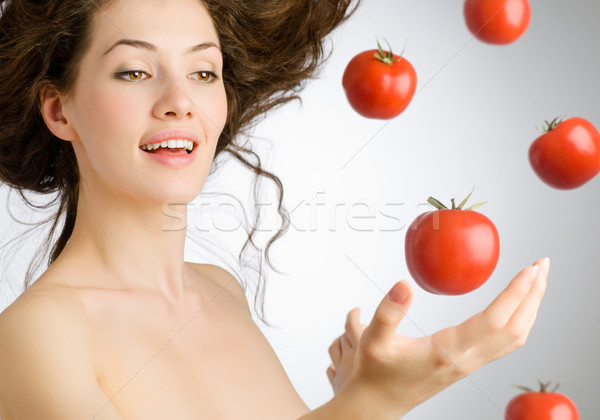 Rouge tomate fille alimentaire sourire Photo stock © choreograph