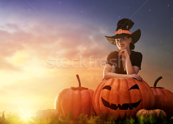 woman in witch costume Stock photo © choreograph