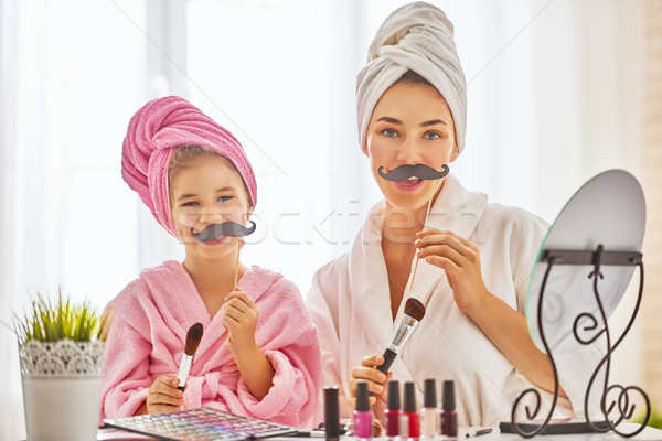 Stock photo: woman and girl with mustache on sticks