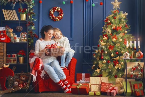 Anya lánygyermek díszít fa vidám karácsony Stock fotó © choreograph