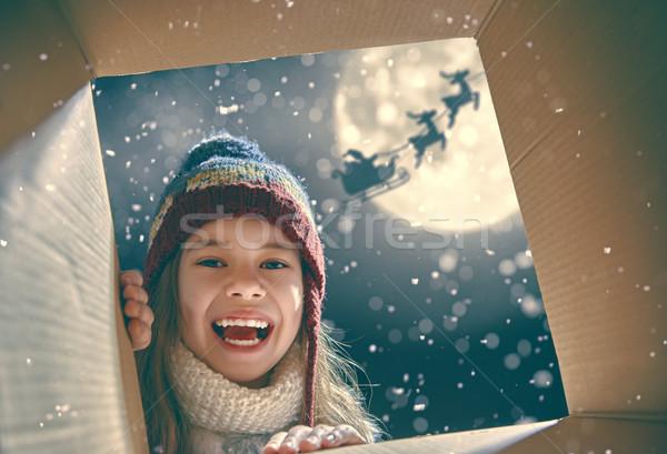 girl opening a present at Christmas Stock photo © choreograph