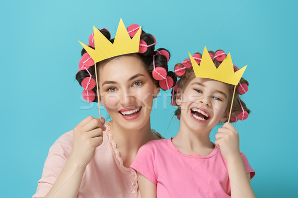 Mother and her daughter with a paper accessories Stock photo © choreograph