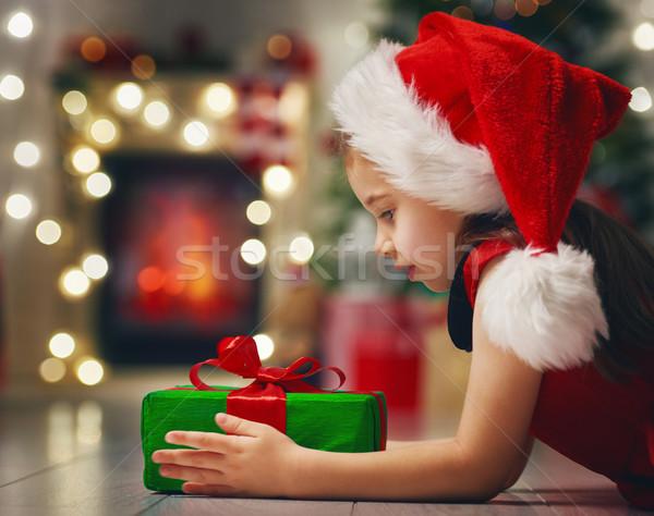 girl holding Christmas gift Stock photo © choreograph