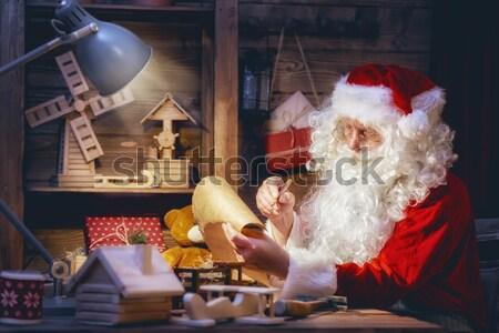 Santa Claus is preparing gifts Stock photo © choreograph