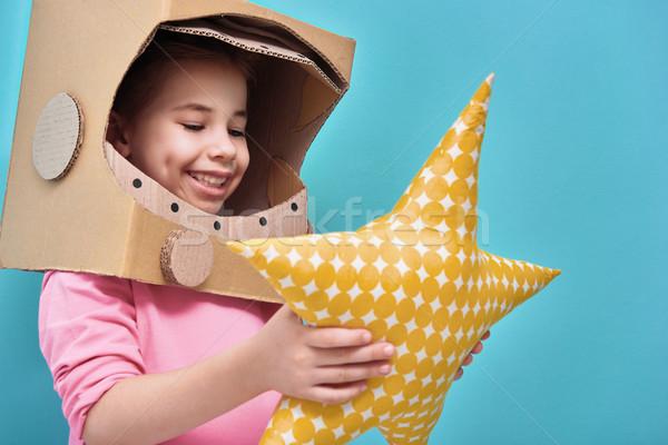 Ragazza astronauta costume bambino giocare Foto d'archivio © choreograph