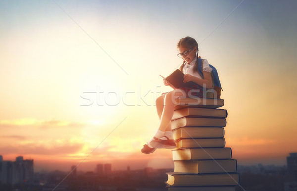 child standing on books Stock photo © choreograph