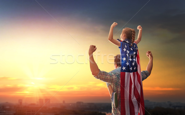Patriotic holiday. Happy family Stock photo © choreograph