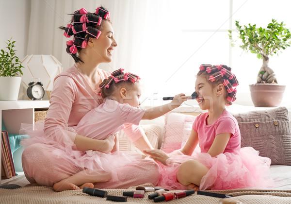 Mom and children doing makeup Stock photo © choreograph