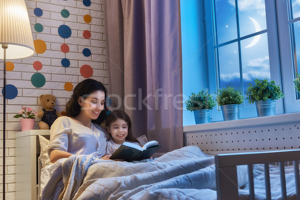 Stock photo: mother reading a book