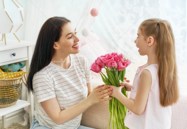 daughter is congratulating mom Stock photo © choreograph