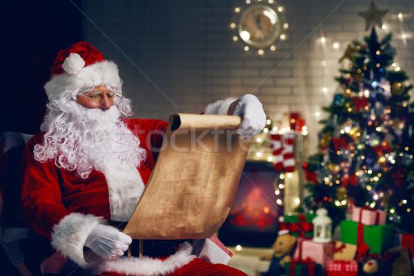 Kerstman portret vergadering kamer home kerstboom Stockfoto © choreograph