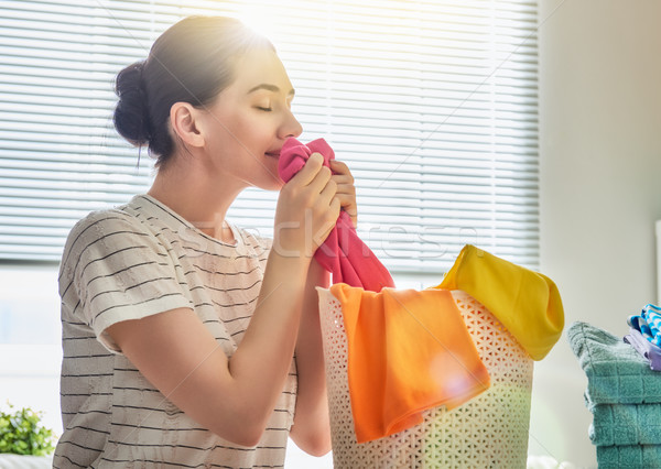 woman is smelling clean clothes Stock photo © choreograph