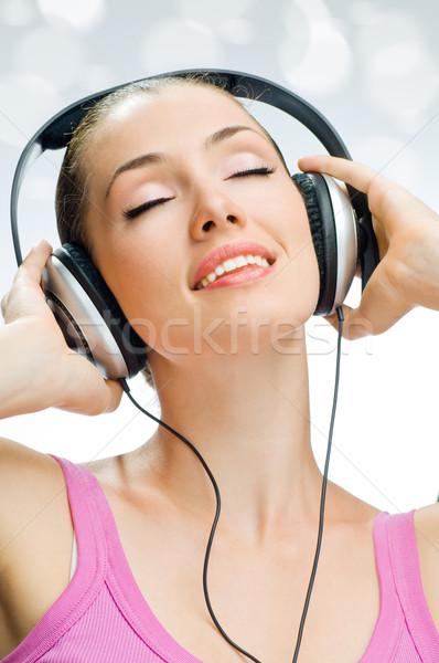Lány fejhallgató fehér zene technológia jókedv Stock fotó © choreograph