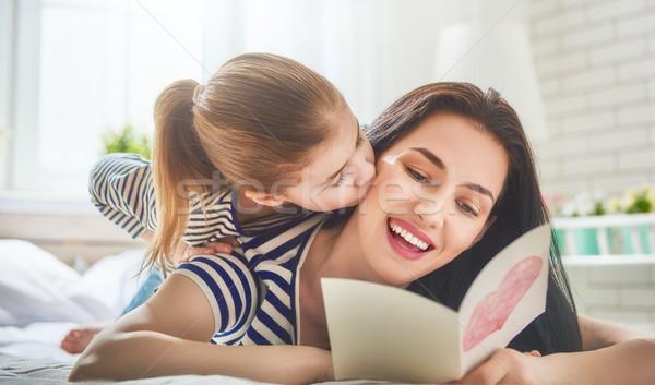 daughter congratulates mom Stock photo © choreograph