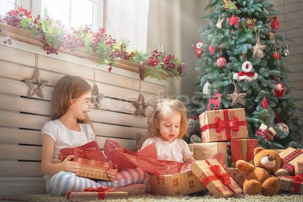 Ragazze apertura regali allegro Natale felice Foto d'archivio © choreograph