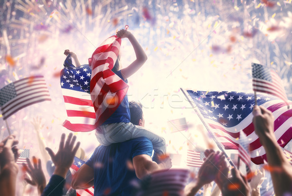 People holding the Flags of the USA. Stock photo © choreograph
