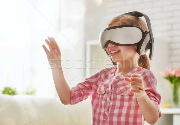 girl playing in virtual reality glasses Stock photo © choreograph