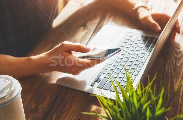 Stock photo: Man is using phone.