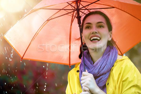 Kadın kırmızı şemsiye mutlu güzel genç kadın Stok fotoğraf © choreograph