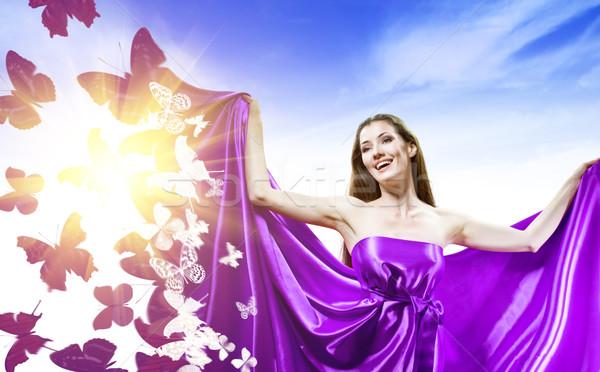 Hosszú ruha gyönyörű fiatal nő lila mosoly Stock fotó © choreograph