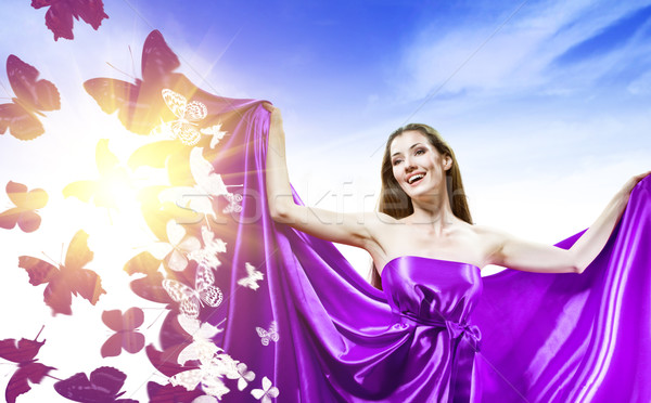 Longo vestir belo mulher jovem roxo sorrir Foto stock © choreograph