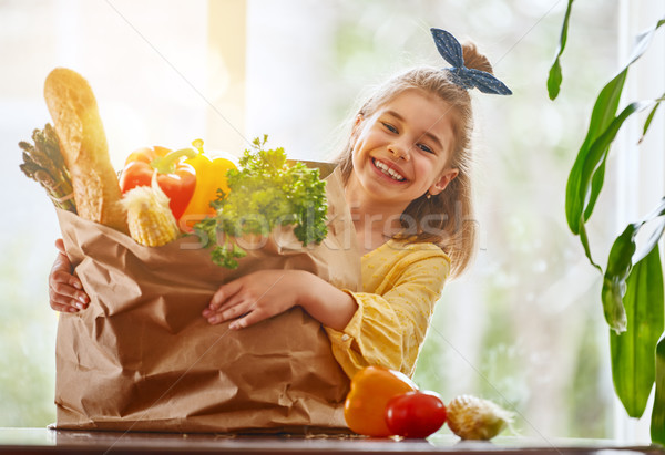 child holding grocery shopping bag Stock photo © choreograph