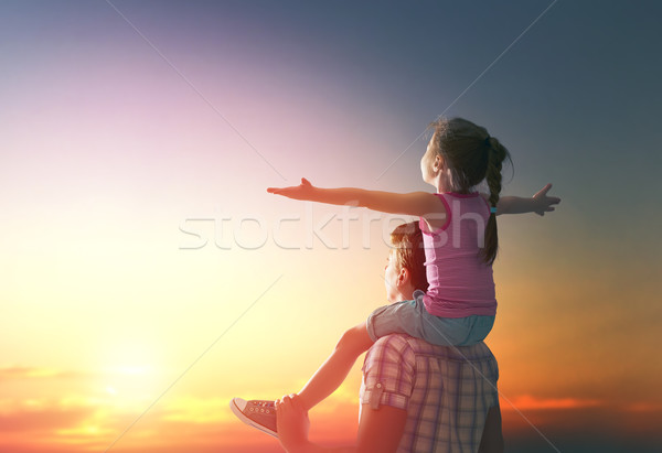 happy family at sunset. Stock photo © choreograph