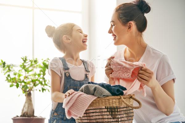 Aile çamaşırhane ev güzel genç kadın çocuk Stok fotoğraf © choreograph