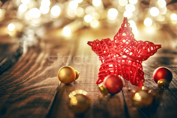 Christmas baubles on wooden background. Stock photo © choreograph