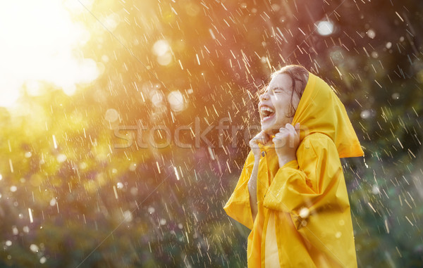Stock photo: child under autumn rain