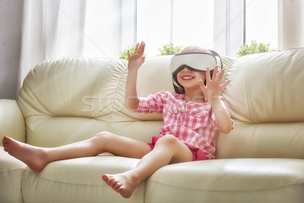 girl playing game in virtual reality glasses Stock photo © choreograph