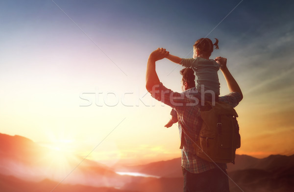 Father and baby at sunset Stock photo © choreograph