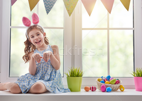 Stock photo: girl wearing bunny ears