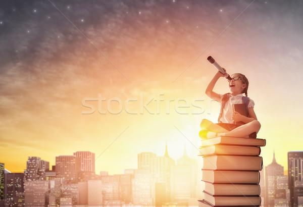 child standing on books Stock photo © choreograph