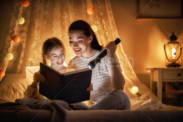 Family reading bedtime. Stock photo © choreograph