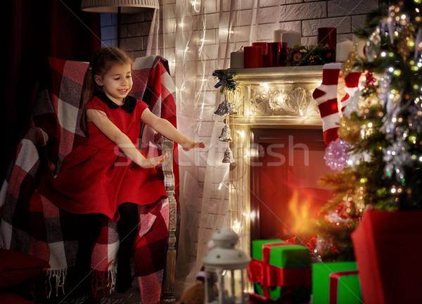 Lány kandalló kezek fa óra otthon Stock fotó © choreograph