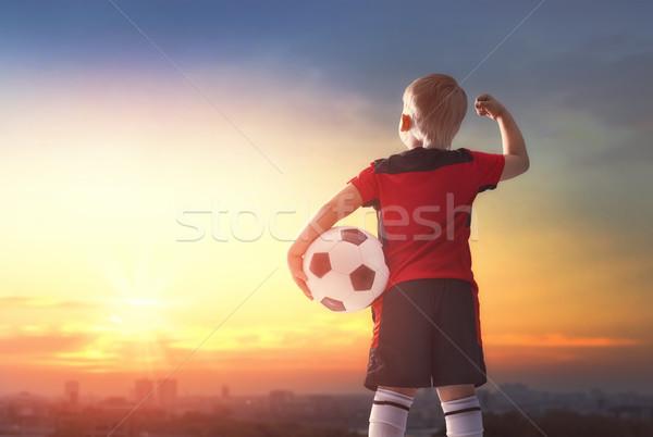 Boy playing football Stock photo © choreograph