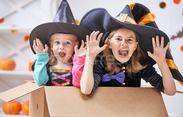 Laughing children in witches costumes. Stock photo © choreograph