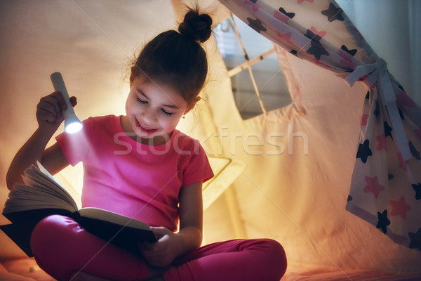 child is reading a book Stock photo © choreograph