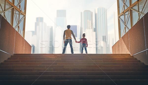 Pai criança subir em cima família arranha-céus Foto stock © choreograph