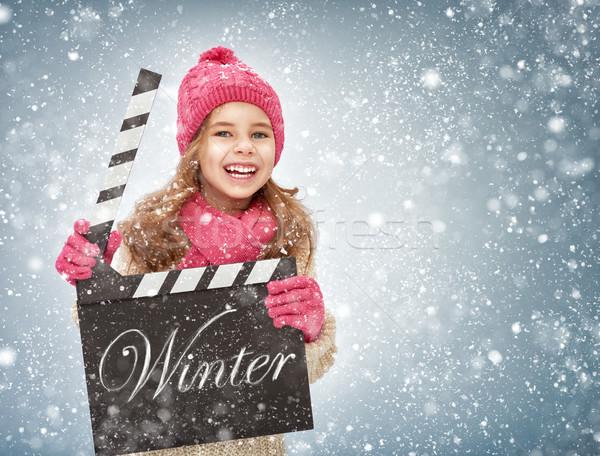 girl holding clapper board Stock photo © choreograph