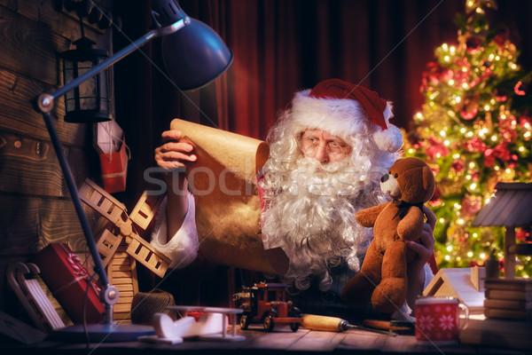 Santa Clause is preparing gifts Stock photo © choreograph