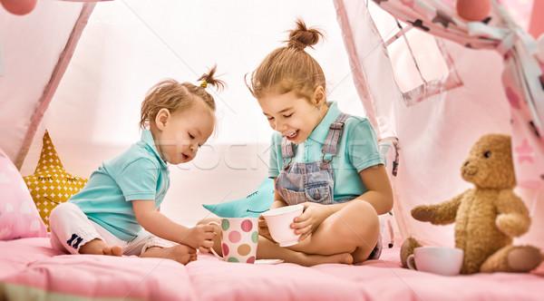 Funny lovely sisters Stock photo © choreograph