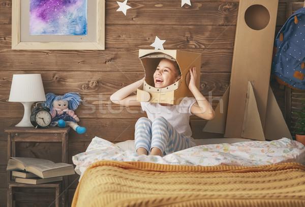 Kız astronot kostüm çocuk oyuncak roket Stok fotoğraf © choreograph