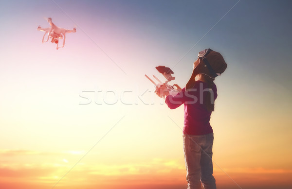 Kid is playing with drone Stock photo © choreograph