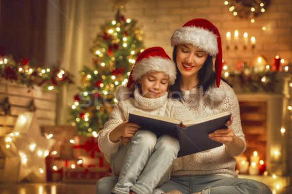 mother reading a book Stock photo © choreograph