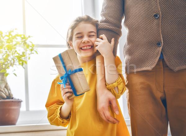 daughter congratulating dad Stock photo © choreograph